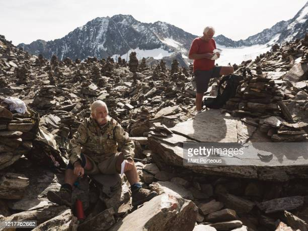 two senior gents take a rest - austria stock pictures, royalty-free photos & images