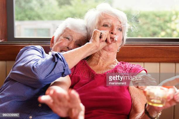 two senior girlfriends 83 years old smoke marijuana together - hemp stock pictures, royalty-free photos & images