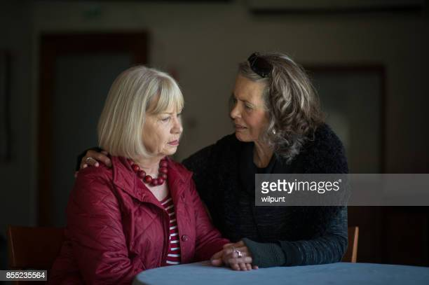 Two senior ladies supporting and listening