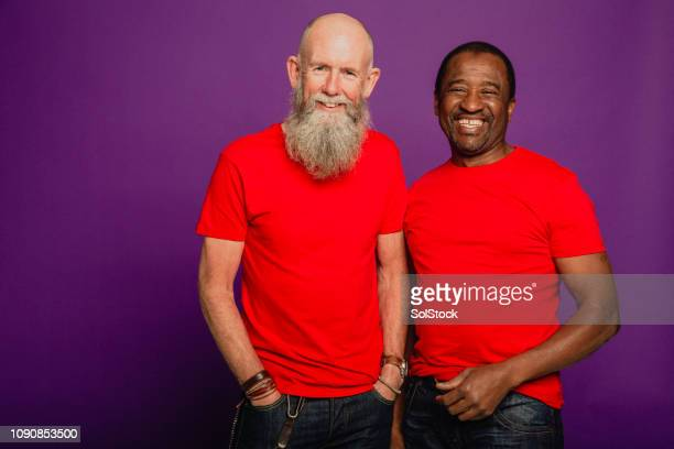 two senior male friends laughing - red shirt stock pictures, royalty-free photos & images