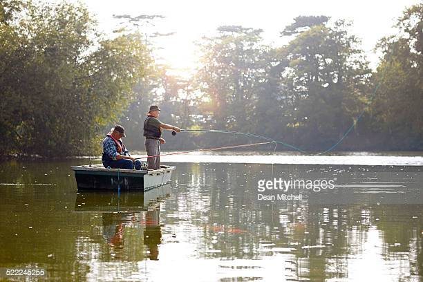 Two senior men in a boat fishing