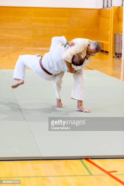 two senior men judo fighting - takedown stock pictures, royalty-free photos & images