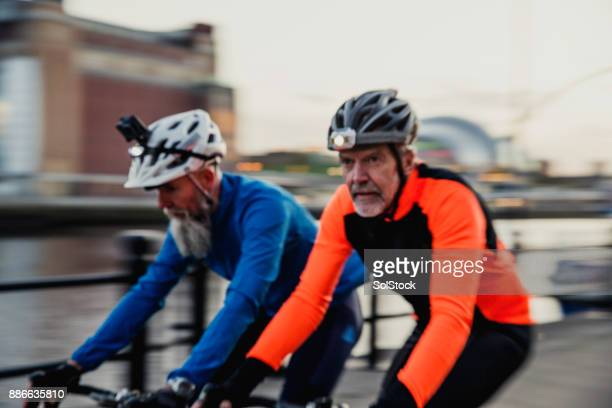 Two Senior Men on Racing Bikes