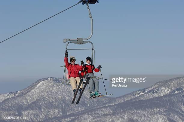 Two senior men on ski lift