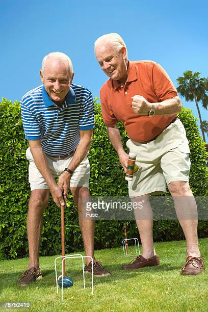 two senior men playing croquet - percussion mallet stock pictures, royalty-free photos & images