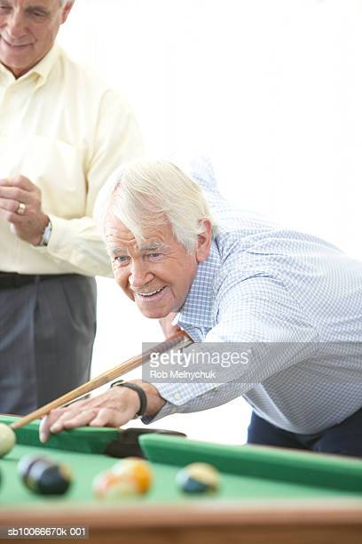 two senior men playing pool, indoors - old men playing pool stock pictures, royalty-free photos & images