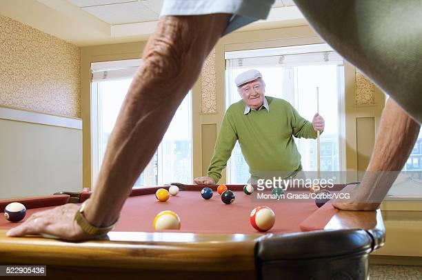 two senior men playing pool - old men playing pool stock pictures, royalty-free photos & images