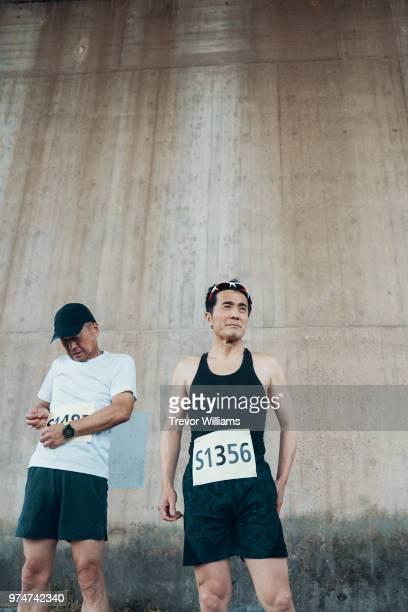 Two senior men preparing to run a marathon