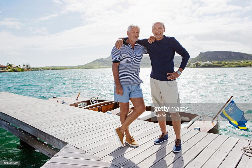 Two senior men standing on jetty : Stockfoto