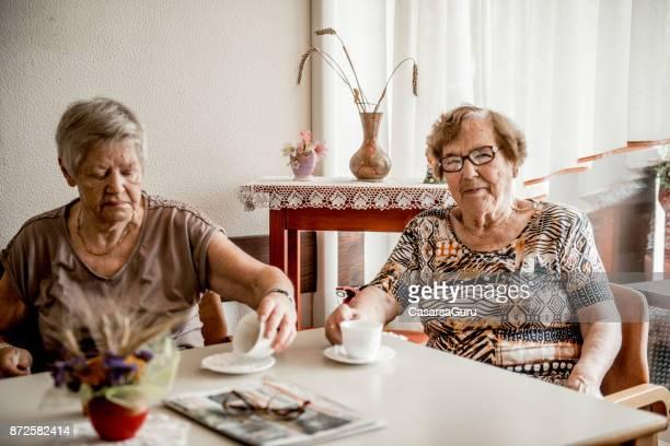Two Senior Women Drinking Morning Coffee