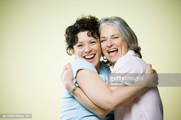 Two senior women embracing, portrait