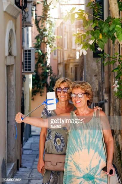 Two Senior women exploring the Corfu town