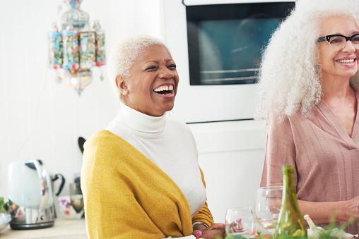two senior women laughing in kitchen - gettyimageskorea