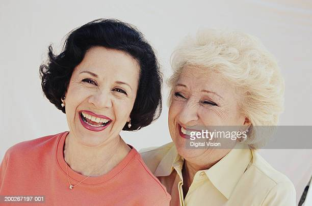 two senior women laughing, portrait, close-up - pink blouse stock pictures, royalty-free photos & images