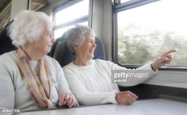 two senior women on train journey