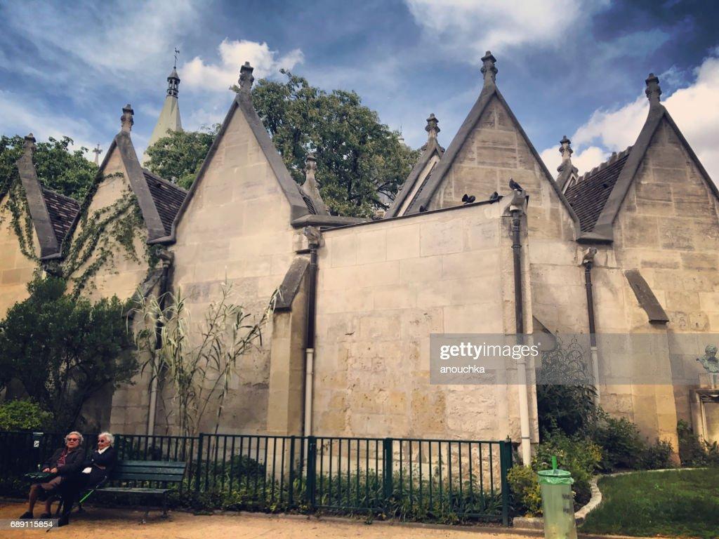Two senior women resting in a park near Saint-Severin Church, Paris, France : Stock Photo
