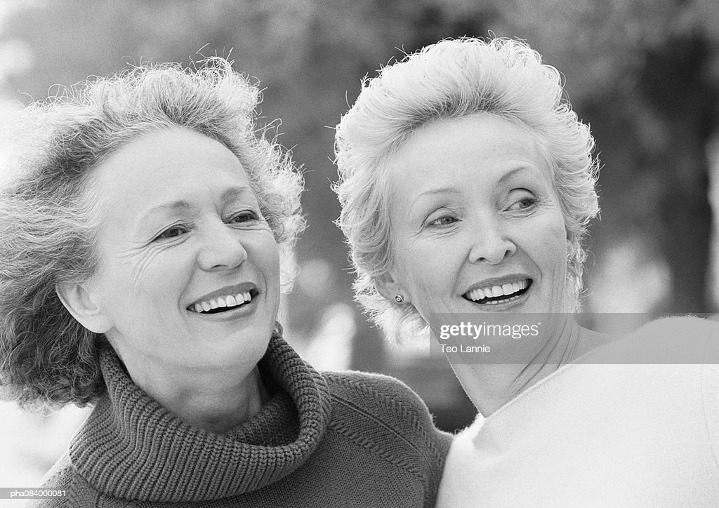 Two senior women smiling, portrait, B&W. : Stockfoto