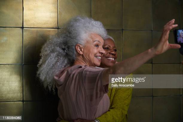 Two senior women taking a selfie together