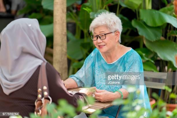 Two senior women talking