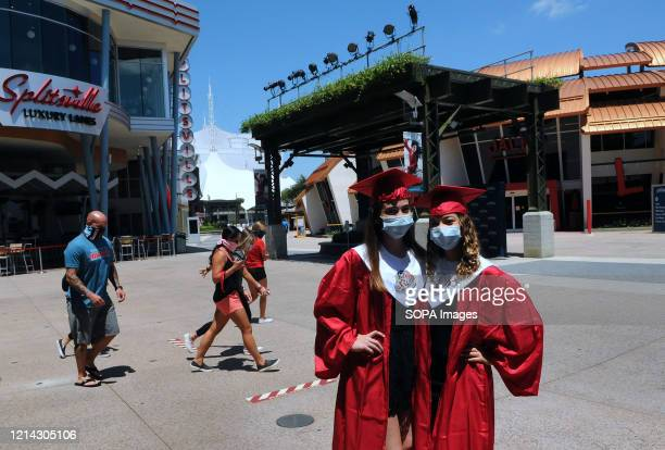 Two seniors from Freedom High School in Orlando who were scheduled to have a graduation ceremony today visit Disney Springs at Walt Disney World on...