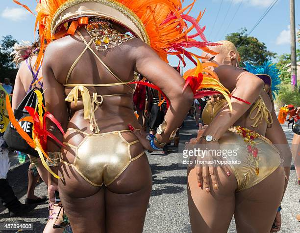 Two sexy Bajan girls behaving provocatively during the Crop Over festival in Bridgetown Barbados 5th August 2013