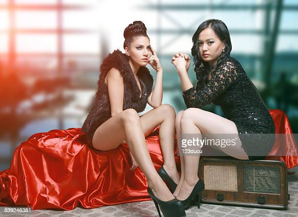 two sexy woman - high heels short skirts stock pictures, royalty-free photos & images