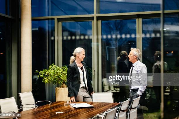 two shareholders talking after meeting - shareholder stock pictures, royalty-free photos & images