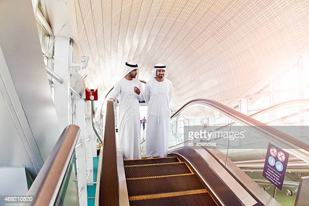 Two Sheiks in Modern Metro Station in Dubai