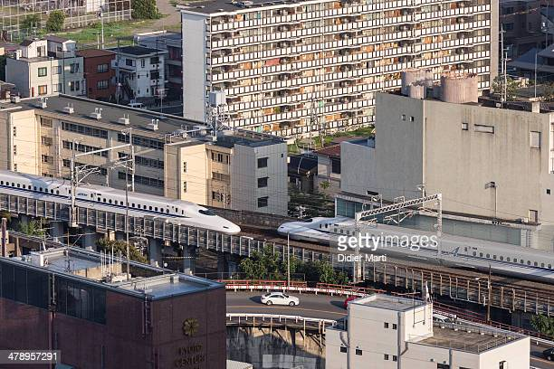 Two shinkansen the japanese high speed trains in the city of kyoto in japan