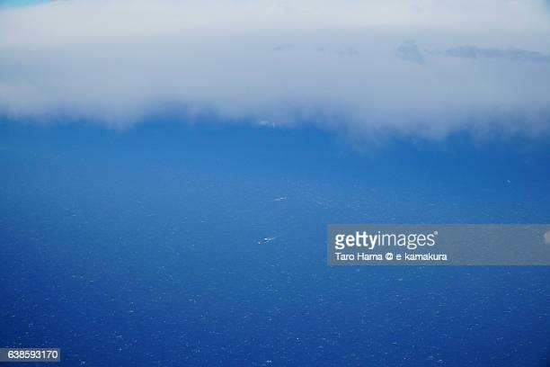 Two ship running under snow cloud - sky view from airplane