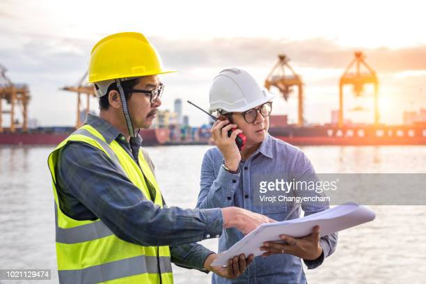 two shipping engineer checking import schedule boat ship cargo ship at port - team captain stock pictures, royalty-free photos & images