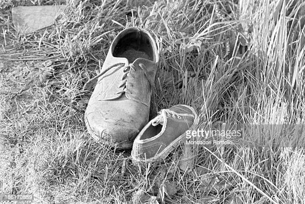 Two shoes left in the grass after the accident during the Mille Miglia Automobile Race Spanish racing driver Alfonso de Portago American navigator...