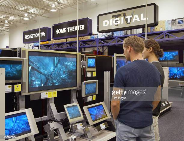 Two shoppers peruse LCD and Plasma televisions at a Best Buy store August 11 2003 in Niles Illinois Best Buy Co Inc raised its estimate for...