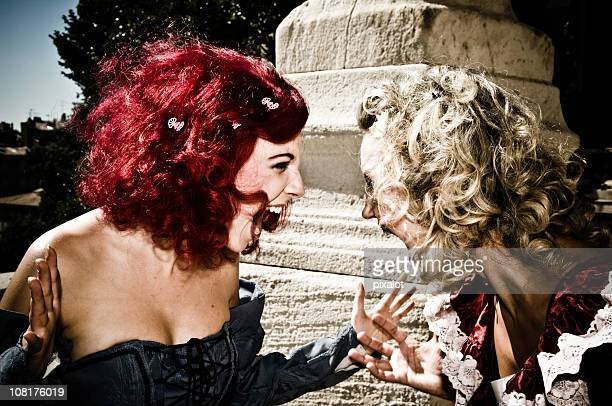 two shouting woman in baroque fashion - burlesque stock pictures, royalty-free photos & images