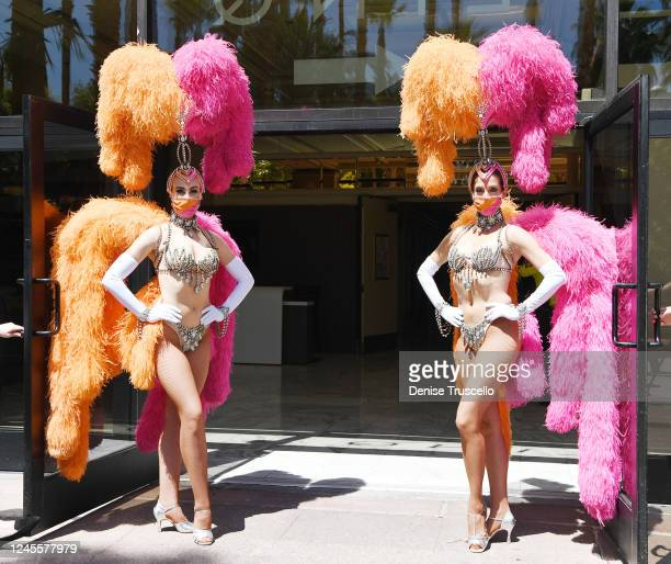 Two showgirls pose for a photo at the reopening of Flamingo Las Vegas on June 4 2020 in Las Vegas Nevada Hotelcasinos throughout the state are...