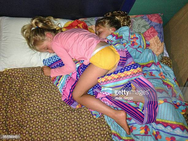 Two siblings intertwined whilst sleeping together