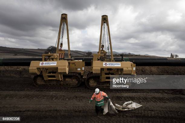 Two sideboom tractors operated by SpiecapagAktor JV lower welded pipe sections into a trench at the 685km point during the construction of the Trans...
