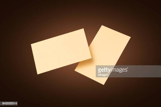 Two Sides of Gold Colored Blank Cards Levitation