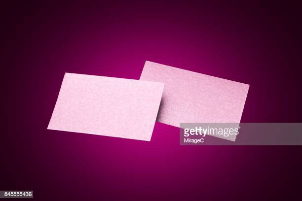 Two Sides of Pink Colored Blank Cards Levitation