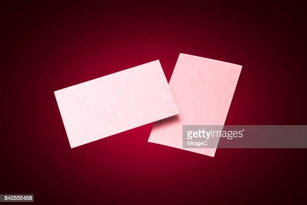 Two Sides of Red Colored Blank Cards Levitation