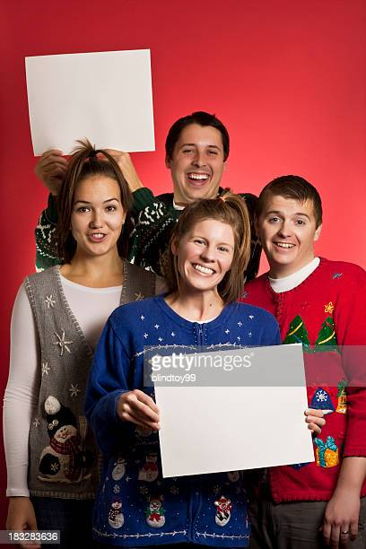 two signs christmas sweater group - ugly christmas sweater party stock pictures, royalty-free photos & images