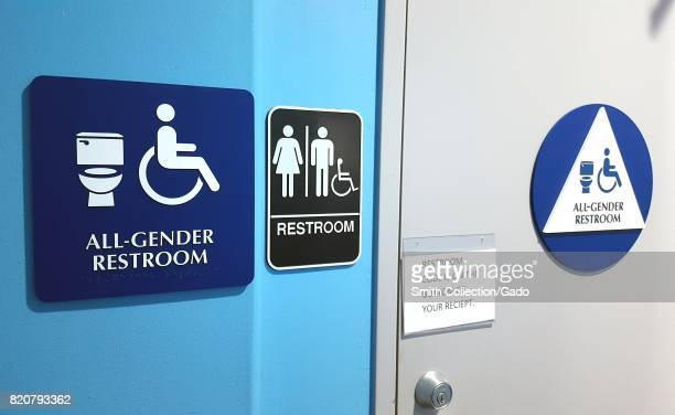 Two signs mark an allgender restroom in the San Francisco Bay Area town of San Ramon California July 20 2017 In 2017 California AB1732 made all...