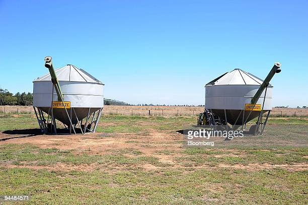 Two silos holding harvested canola seeds stand beside a canola field in Point Wilson outside of Melbourne Australia on Tuesday Dec 15 2009 Canola...