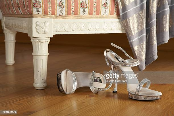 two silver high-heeled womans sandals on wooden floor, close-up - judith gray stock pictures, royalty-free photos & images