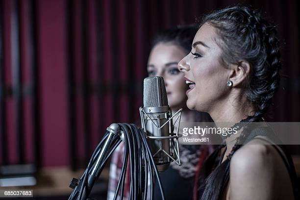 Two singers at recording studio