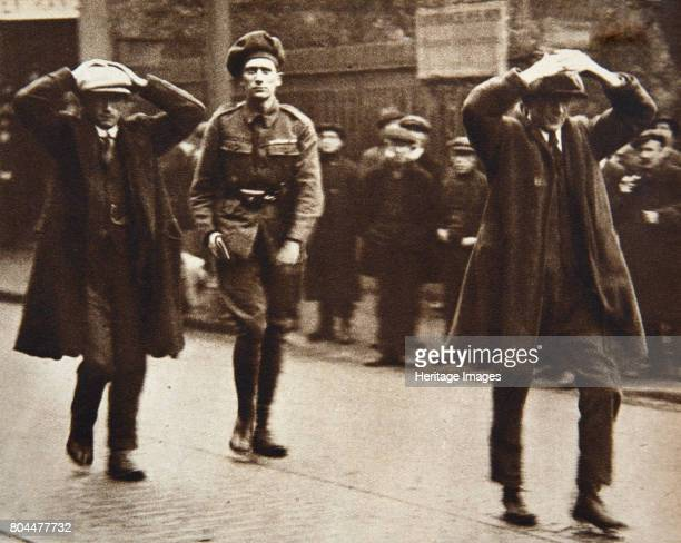 Two Sinn Fein members arrested by British troops, Dublin, Ireland, 1920. A scene during the Irish War of Independence. Two Sinn Fein members arrested...