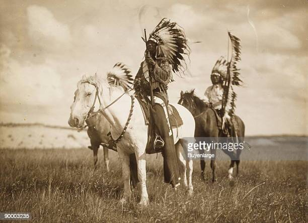 Two Sioux Chiefs on Horseback in full War Regalia