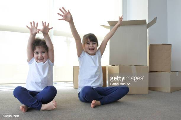 Two sister girls moving into a new apartment in Auckland