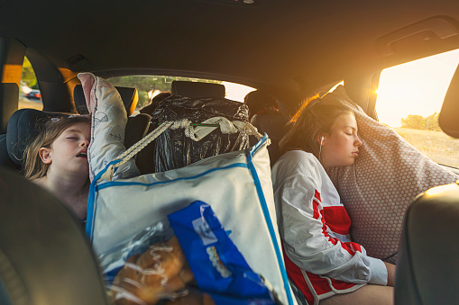 Two sisters asleep on roadtrip - gettyimageskorea