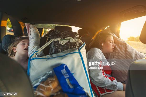 two sisters asleep on roadtrip - real life stock pictures, royalty-free photos & images